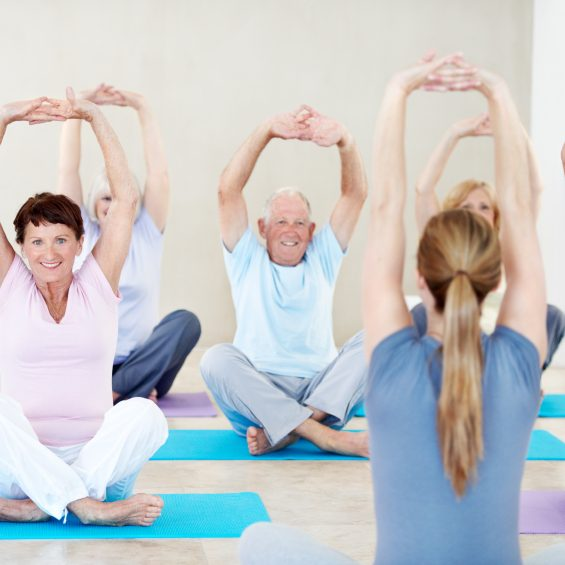 Shot of a group of happy seniors in a yoga class